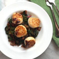 More CSA chard! Just when my husband thought that he couldn't eat any more greens, I cooked them with bacon and topped them with scallops. :) I served this dish with corn muffins on the side …