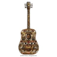 Dolan Geiman Collection This guitar wall sculpture art is assembled from salvaged wood and found objects including industrial metal pieces like vintage keys, s
