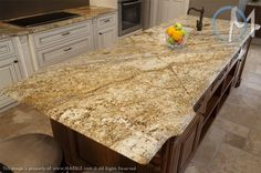 The dramatic veining of Yellow River Granite with a cove bullnose edge is featured prominently on this island. www.marble.com