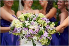 Bridal party all places their boquet together for a cute and fun photo at Medina Country Club Wedding