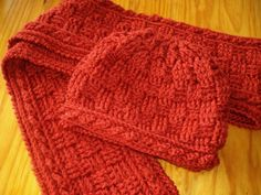This is a crochet pattern for a warm, hat and scarf, which is worked in Aran Wool. The pattern is basket weave, which is very warm because of the almost double construction. The border of the scarf an