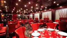 Boscolo Aleph Roma: Cherrywood-paneled walls and scarlet accents decorate the on-site restaurant, Sin.