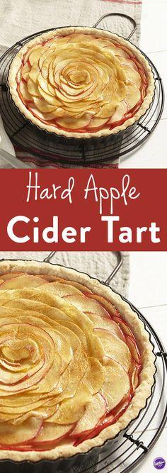 Hard Apple Cider Tart Recipe - An apple tart with a kick. Hard Apple Cider Tarts play up crisp, light apple flavor with the refreshing bite of hard cider. Makes 10-12 servings.