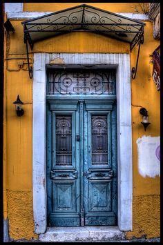 Blue door, yellow wall, via Flickr.