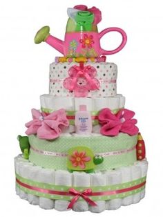 """A """"diaper cake"""" perfect baby shower gift! i've seen some impressive diaper cakes but this one definitely """"takes the cake. Baby Cakes, Baby Shower Cakes, Fiesta Baby Shower, Baby Shower Diapers, Diaper Cakes, Nappy Cake, Baby Showers, Baby Shower Parties, Baby Shower Gifts"""
