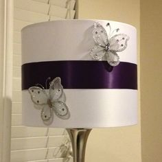 DIY lamp shade.  Took a plain white lamp shade added some ribbon and butterflies to customize it to my colors and room.