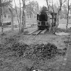 Vught Concentration Camp: The crematorium oven at Vught concentration camp. In the foreground is a pile of the ashes of human bodies.