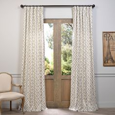 This printed curtain panel by Martinique brings contemporary style to any window in your home. Designed with a rod pocket and back tab for versatility, this 100 percent cotton panel complements a vari