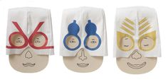 The Kami-Men by Kami Play are three amusing envelopes that look like faces wearing wrestling masks. Each mask's design draws on a traditional Japanese concept: the red one looks like the decorative mizuhiki paper-cords found on Japanese gift envelopes, while the blue and yellow ones bear motifs based on gourds and arrows, which are lucky symbols in Japan.