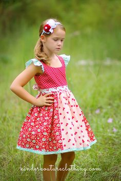 Another gorgeous dress full of color and lovely floral and strawberry prints. This dress includes a classic bodice, buttons in the back, flutter sleeves and a sewn in sash. 100% Cotton fabric. This ha