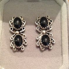 Vintage black onyx earrings Vintage Sterling Native American stud earrings with 2 black onyx stones in a saw tooth setting showing some tarnish. Not marked but tested Vintage Jewelry Earrings