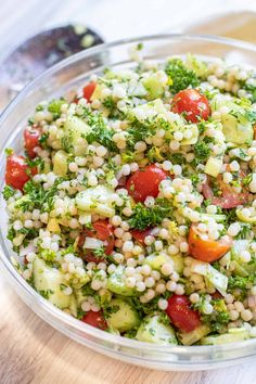 This Israeli Couscous Cucumber Salad is your new favorite summer salad! It's bright, light with fresh herbs and summer garden vegetables, but with the Israeli couscous, it also makes it hearty enough for lunch and the perfect summer side! Cucumber Salad, Couscous, Summer Salads, Vegan Friendly, Fresh Herbs, Pasta Salad, Holiday Recipes, Salad Recipes, Vegetarian Recipes