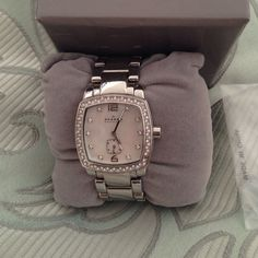 Skagen stainless watch  with Swarovski face Great preowned shape- missing 1 stone on right bottom, usual wear near clasp. Mother of pearl face, stainless steel case. Needs battery Skagen Accessories Watches