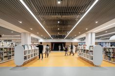Tainan Public Library Shows the Art of the Modern Library - gb&d Adobe Photoshop, Lightroom, Public Library Design, Modern Library, Sunken Patio, Library Pictures, Contemporary Light Fixtures, Multipurpose Room, Exhibition Space
