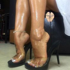 Black mules and oiled feet
