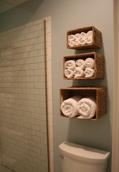 Simply attach woven baskets to your walls for extra storage space and easy access to towels, linens and more. (I'm Busy Procrastinating)