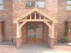 Hand made oak porch by wow.bespoaktimberframes.co.uk