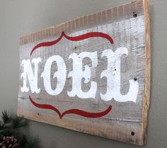 This lovely, rustic wall art sign was constructed of locally sourced reclaimed wood and hand painted in white with the word NOEL. It would be