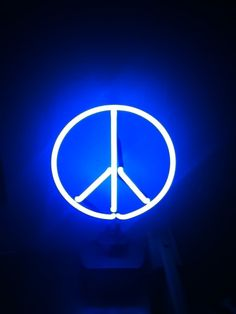 My neon peace sign light that shines in my room every night