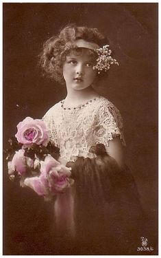 vintage photo of young girl with bouquet of roses