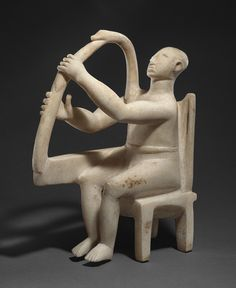 Seated harp player, ca. 2800–2700 B.C.; Early Cycladic I–II  Cycladic; Grotta-Pelos culture  Marble