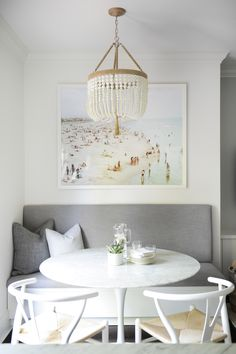 Small dining rooms need to be created thoughtfully. We introduced a built-in seating in a monochromatic palette to this dining room. Fully designed with a chandelier to soften the space.