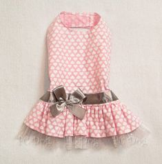 - Pretty Shimmery Hearts dress - Light Pink background with white hearts - Shimmery Tulle underskirt - Silver ribbon and bow at waist - It easily attaches with adjustable velcro neck and belly straps