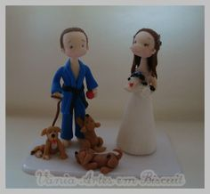 Cake toppers - traditional in Brazil. It's all personalized, showing something to do with your hobby's! I totally recommend it! too cute!