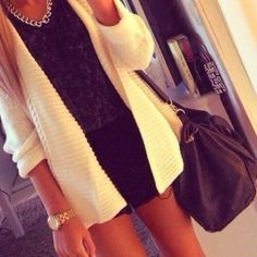 Oversized white cardigan and black shorts with silver necklace