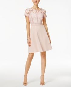 Ivanka Trump Illusion Lace A-line $158.00 You'll look as pretty as a picture in this gorgeous lace number from Ivanka Trump.