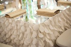 textured table cloth with mirrored top - not necessarily THAT tablecloth, but I LOVE the idea!