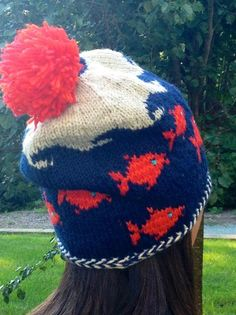 """Big FIsh Hat  $3.50 on Ravelry and Craftsy. Random Fish swimming under the waves, a slouchy hat with a braided brim.   Companion hat to """"little fish skull cap"""""""