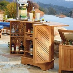 This handsome Outdoor Teak Bar is crafted to resists the elements, yet weathers to a silvery gray patina over time. Inside, you'll find plenty of smartly designed spaces for storing bottles, glasses, and other barware.