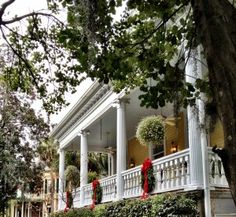 A perfect Southern holiday porch!  I want a porch like this!