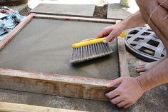 DIY Concrete Pavers – make molds out of 2×4′s and plywood with inside measurements of approximately 24″ square which then will take one 60 lb. bag of Quikcrete.