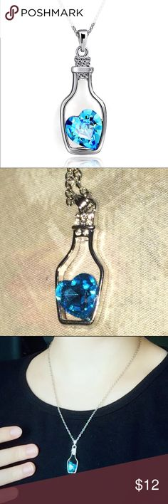 (J1) Blue Heart Necklace Super cute silver toned necklace. Cute heart in a bottle. New in package. Jewelry Necklaces