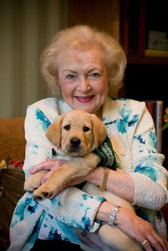 Betty White with a guide dog puppy in training. Betty is a great advocate for dogs and a board member of the Morris Animal Foundation.