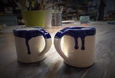 White clay coffee cups. Deep blue