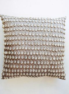 Cowry shell pillow. For looks. Not your face. LOL. Would be cute to do with a shape, such as a wave