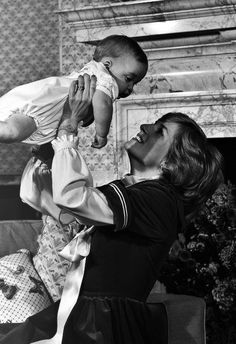 dianaspot:  The Princess of Wales lifting her son Prince William at Kensington Palace, London, in 1982.