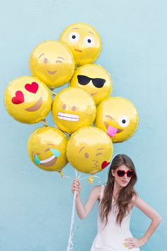 DIY Emoji Balloons, these are so awesome and would make for a very fun photo booth as well! :)