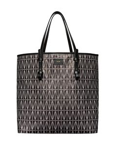 House of Dagmar shopping bag is the perfect everyday bag. Crafted from canvas the bag is monogrammed in House of Dagmar signature grid print. Lightweight leather handles and an interior zipped patch-pouch. The tote is ideal for any occasion – from work to weekend trips.