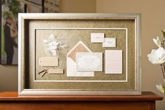 We love the elegant vibe of this custom framed wedding invitation done by one of our Pictures Plus associates.