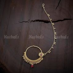 Designer antique nath studded with synthetic ruby stones and plated with antique gold polish and made of copper alloy   #nath #jewellery #antique #kushalsfashionjewellery