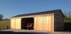 Bespoke garage with cedar cladding Timber Garage, Cedar Cladding, Car Barn, Garage Ideas, Garages, Bespoke, Shed, Construction, Inspire