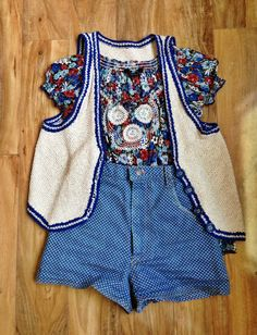Peasant shirt, knitted vest, high rise polkadot shorts.  (The jah'lyssa outfit: because I wore it the day I went to go pick up jah'Lyssa) *SHIRT GONE**