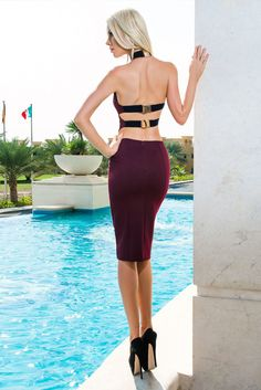 Miranda Kerr may have worn white, but this burgundy dress with its unusual straps is a great way of incorporating red carpet style into your party dress.