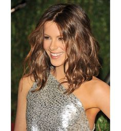 """""""If you want to look slimmer, definitely don't go for blunt haircuts like the Louise Brooks–style bob that Katie Holmes and Rihanna have worn,"""" says Blandi. """"Instead, opt for a longer, shaggy bob with softness and movement."""" RELATED ON ELLE: DIY Bangs"""