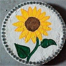 See a picture of a home-made garden stepping stone made by me. It features a painted picture of a sunflower.