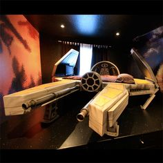 Starship Fighter Bed - This is an incredible space-themed bedroom with this over-the-top bed. You can fall asleep dreaming about conquering new worlds, or just settle in for some classic Star Wars movies on the television!